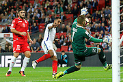 Malta Goalkeeper Andrew Hogg makes a save from England Midfielder Theo Walcott during the FIFA World Cup Qualifier match between England and Malta at Wembley Stadium, London, England on 8 October 2016. Photo by Andy Walter.