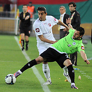 Konyaspor's Ugur YANIKDEMIR (R) Karsiyakaspor's Ercag EVIRGEN (L) during their Play Off Second leg match at AliSamiYen Stadium in Istanbul Turkey on Thursday, 20 May 2010. Photo by TURKPIX
