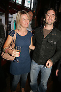 Georgina Bouz and Henry Brett, PJ's Annual Polo Party . Annual Pre-Polo party that celebrates the start of the 2007 Polo season.  PJ's Bar & Grill, 52 Fulham Road, London, SW3. 14 May 2007. <br /> -DO NOT ARCHIVE-© Copyright Photograph by Dafydd Jones. 248 Clapham Rd. London SW9 0PZ. Tel 0207 820 0771. www.dafjones.com.