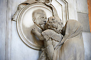 Picture and image  of the stone sculpture of a child being lifted to kiss the deceased.  The Casella tomb sculptor G Benetti 1884. Section A, no 40, monumental tombs of the Staglieno Monumental Cemetery, Genoa, Italy .<br /> <br /> Visit our ITALY PHOTO COLLECTION for more   photos of Italy to download or buy as prints https://funkystock.photoshelter.com/gallery-collection/2b-Pictures-Images-of-Italy-Photos-of-Italian-Historic-Landmark-Sites/C0000qxA2zGFjd_k<br /> If you prefer to buy from our ALAMY PHOTO LIBRARY  Collection visit : https://www.alamy.com/portfolio/paul-williams-funkystock/camposanto-di-staglieno-cemetery-genoa.html
