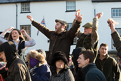 © Licensed to London News Pictures. 2/1/2016. Atherstone, North Warwickshire, UK. The annual New Year meet of the Atherstone Hunt took place in the market square earlier today. Anti-Hunt protesters were also in the square and the Police were called after scuffles broke out during the meet. A police helicopter monitored the situation as the protestors sought sanctuary in a nearby car park, whilst waiting for the arrival of Police on foot. Pictured, Anti-Hunt protestors are jeered by people in the crowd. Photo credit: Dave Warren/LNP