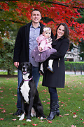 Family portrait with baby girl and Great Dane dog in Boston Public Gardens