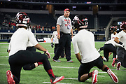 Iraan High School football head coach Mike Kirchhoff looks on during warmups before the state championship game at AT&T Stadium in Arlington, Texas on December 15, 2016. (Cooper Neill for The New York Times)