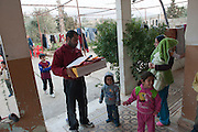 Distribution of help goods by Caritas to Syrian refugees who arrived from Babr Amro, Homs. Aarsal, Bekaa valley, Lebanon.