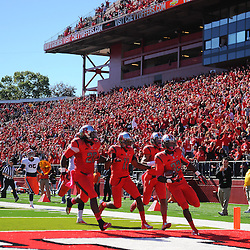 Oct 13, 2012: Rutgers Scarlet Knights defensive back Duron Harmon (32) scores on a blocked field goal return with a bunch of teammates during NCAA Big East college football action between the Rutgers Scarlet Knights and Syracuse Orange at High Point Solutions Stadium in Piscataway, N.J.
