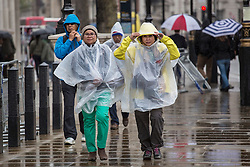 © licensed to London News Pictures. London, UK 09/05/2013. People walking under the rain in central London on Thursday, 09 May 2013. Photo credit: Tolga Akmen/LNP