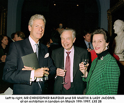 Left to right, MR CHRISTOPHER BALFOUR and SIR MARTIN & LADY JACOMB, at an exhibition in London on March 19th 1997.LXE 28