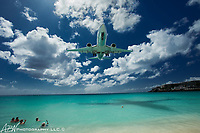 Princess Juliana International Airport. Simpson Bay, St. Maarten. SXM airport is known for planes flying low over Maho Beach as they come in for landing. <br /> <br /> Photograph by Alan Brian Nilsen ©Alan Brian Nilsen/ABN photography