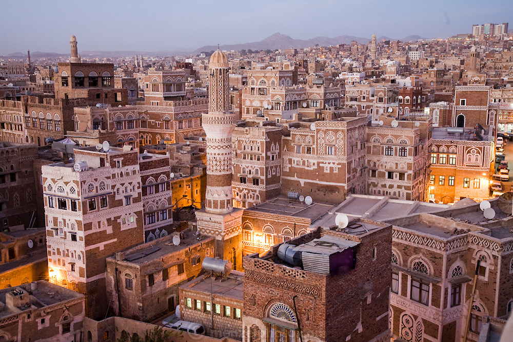 The view from the roof of an 8 story hotel in old Sanaa, Yemen's capital, is a rough blend of the old and the new, with satellite dishes perched on the roofs of ancient buildings.