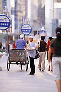 Old paper seller in Yinchuan in modern shopping Mall.  Ningxia Province, China.