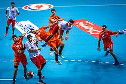 The Dutch handball player vlnr Jorn Smits, Mehmet Demirezen, Samir Benghanem, Gorkem Bicer in action during the European Championship qualifying match against Turkey in the Topsport Center Almere.