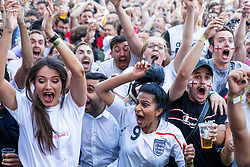 © Licensed to London News Pictures. 11/07/2018. London, UK. England fans in Flat Iron Square celebrate England's first goal as they watch England play Croatia in the World Cup semi-final. Photo credit: Rob Pinney/LNP