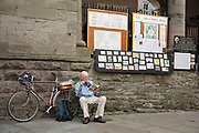 "Elderly gentleman sitting beside his bicyle reading The Economist magazine in Hay-on-Wye or Y Gelli Gandryll in Welsh, known as ""the town of books"", is a small town in Powys, Wales famous for it's many second hand and specialist bookshops, although the number has declined sharply in recent years, many becoming general antique shops and similar."