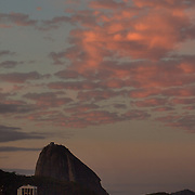 A view of Sugar Loaf mountain and Copacabana beach at sunset. The boulder shaped mountain, one of the most famous land marks in Rio de Janeiro,  boasts magnificent views and can be reached by cable car. Rio de Janeiro, Brazil. 19th July 2010. Photo Tim Clayton..