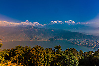 View down to Phewa Lake with the mountains of the Annapurna Massif of the Himalayas in the background, Pokhara, Nepal.