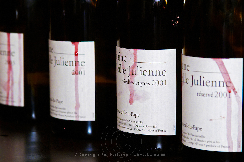 Bottles of Domaine Vieille Julienne Viellies Vignes and Reserve 2001, Chateauneuf-du-Pape, details of labels with streaks drips soiled of red wine  Chateauneuf-du-Pape Châteauneuf, Vaucluse, Provence, France, Europe  Chateauneuf-du-Pape Châteauneuf, Vaucluse, Provence, France, Europe