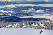 Skiers on Chair 2 runs above the town of Whitefish, Montana, USA