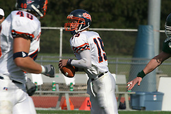 22 October 2005: Thunder QB Jeremy Chupp drops back looking for a receiver. The Illinois Wesleyan Titans posted a 23 - 14 home win by squeeking past the Thunder of Wheaton College at Wilder Field (the 5th oldest collegiate field in the US) on the campus of Illinois Wesleyan University in Bloomington IL