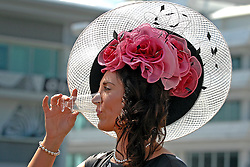 04/06/2010..Ladies Day at the Oaks meeting at Epsom racecourse, Surrey, Britain, 03 June 2010. .The Oaks Stakes is a Group 1 flat horse race for three-year-old thoroughbred fillies. It is run over a distance of 1 mile 4 furlongs and 10 yards (2,423 m) at Epsom Downs Racecourse always in early June. It is one of five British Classic Races...