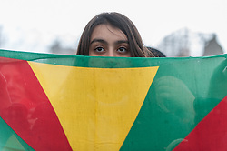 "© Licensed to London News Pictures. 06/03/2016. London, UK. One of the demonstrators gathered in Trafalgar Square for the ""Stop Turkey's war on Kurds - Break the silence"" protest calling an end to the siege and mass murder of Kurdish people in Turkey. Photo credit : Stephen Chung/LNP"