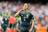 Chris Gunter of Wales says chin up to the Wales fans at the end of the match.  Euro 2016, group B , England v Wales at Stade Bollaert -Delelis  in Lens, France on Thursday 16th June 2016, pic by  Andrew Orchard, Andrew Orchard sports photography.