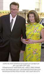 LORD & LADY SAATCHI at a party in London on 4th July 2001.OPY 202