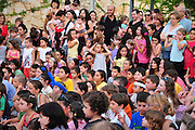 Israel, Haifa, Outdoor, Summer entertainment for children. Clowns and acrobats perform for children