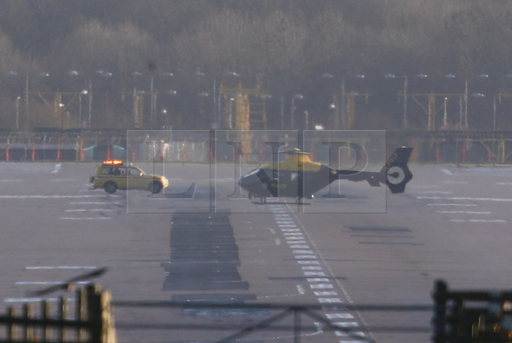 © Licensed to London News Pictures. 20/12/2018. London, UK. A police helicopter lands on the runway at Gatwick Airport. Flights have been cancelled and thousands of passengers have been delayed after the airport closed due to two drones being spotted nearby. Photo credit: Peter Macdiarmid/LNP