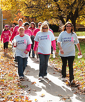 Ann Zanes, Tammie Samson and Kim Leblanc walk in memory of their friend, Jennifer, who lost her battle with cancer in August during Sunday's Making Strides Against Breast Cancer in Laconia.   (Karen Bobotas/for the Laconia Daily Sun)