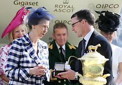The Princess Royal presents a prize to winning trainer Aiden O'Brien after Highland Reel wins the Prince Of Wales's Stakes during day two of Royal Ascot at Ascot Racecourse.