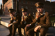In late afternoon, three conscript soldiers  of the Polish army are dressed in brown uniforms eating ice cream cones in Plac Zamkowy, outside the Royal Castle in Warsaw, Poland. The Polish army (Wojsko Polskie) is the name applied to the military forces of Poland. The name has been used since the early 19th century, although it can be used to refer to earlier formations as well. Polish Armed Forces consist of the Army (Wojsko Lądowe), Navy (Marynarka Wojenna) and Air Force (Siły Powietrzne) branches and are under the command of the Ministry of Defense (Ministerstwo Obrony Narodowej). The combined Polish armed forces consist of 215,000 active duty personnel and in addition 450,000 reserves. The armed forces are made up of conscripts who serve for a period of 9 months, and professional soldiers.