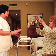 Home health care worker helps Elearnor Siegman at her Los Angeles area home. Please Contact Me With Licensing Questions or Requests.