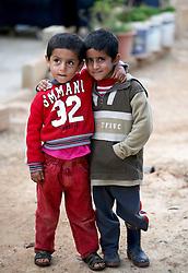Syrian refugee children in the settlement camp where they live amongst an olive grove in Koura, near Tripoli, Lebanon.