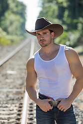 cowboy looking down train tracks