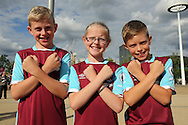 a Group of young West Ham fans posing outside London Stadium before k/o. UEFA Europa league, 3rd qualifying round match, 2nd leg, West Ham Utd v NK Domzale at the London Stadium, Queen Elizabeth Olympic Park in London on Thursday 4th August 2016.<br /> pic by John Patrick Fletcher, Andrew Orchard sports photography.