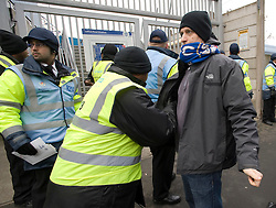 © Ben Cawthra. 28/01/2012.  Chelsea supporters being searched by security before the Barclays Premiership football match between QPR and Chelsea. Security has been heightened due to tensions between the clubs following an on field alleged racial incident. Photo credit : Ben Cawthra