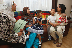 Health visitor visiting families at home.