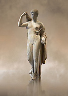 """Aphrodite of Fréjus in the style known as """"Venus Genetrix"""". A 1.64m high Roman statue, dating from the end of the 1st century BC to the start of the 1st century AD, in Parian marble, was discovered at Fréjus (Forum Julii) in 1650. It is considered as the best Roman copy of the lost Greek work. Louvre Museum, Paris<br /> <br /> The Venus Genetrix style of statue depicts Aphrodite (Venus to the Romans) as Genetrix ( Latin for Mother). This sculptural type was adopted by the Julia-Claudian dynasty after Julius Caesar claimed that he was defended from Venus herself.  The original lost Greek statue is attributed to Greek sculpture Callimachus who created a Bronze Aphrodite in 420-410. According to Pliny's Natural History showing her dressed in a light but clinging chiton or peplos, which was lowered on the left shoulder to reveal her left breast and hung down in a sheer face and decoratively carved so as not to hide the outlines of the woman's body. Venus was depicted holding the apple won in the Judgement of Paris in her left hand, whilst her right hand moved to cover her head. From the lost bronze original are derived all surviving copies. The composition was frontal, the body's form monumental, and in the surviving Roman replicas its proportions are close to the Polyclitean, an ancient Greek sculptor in bronze of the fifth century BC. .<br /> <br /> If you prefer to buy from our ALAMY STOCK LIBRARY page at https://www.alamy.com/portfolio/paul-williams-funkystock/greco-roman-sculptures.html- Type -    Louvre    - into LOWER SEARCH WITHIN GALLERY box - Refine search by adding a subject, place, background colour,etc.<br /> <br /> Visit our CLASSICAL WORLD HISTORIC SITES PHOTO COLLECTIONS for more photos to download or buy as wall art prints https://funkystock.photoshelter.com/gallery-collection/The-Romans-Art-Artefacts-Antiquities-Historic-Sites-Pictures-Images/C0000r2uLJJo9_s0c"""
