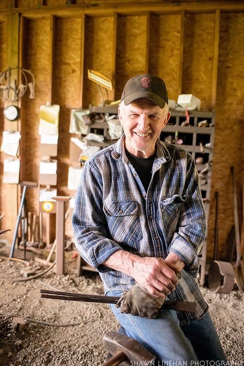 Portrait of Bob Denman in his forge in Boring, Oregon