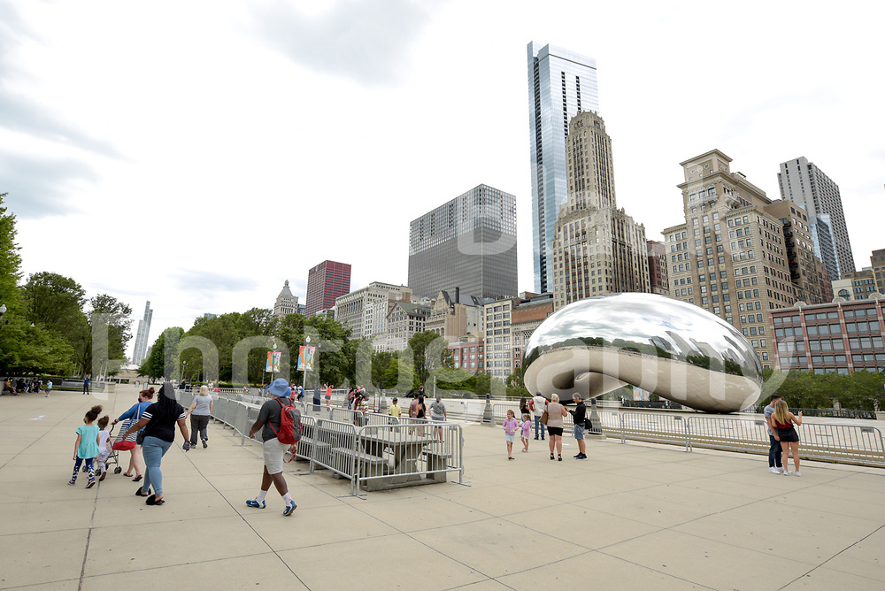 The Cloud Gate sculpture better known locally as the Bean is a major tourist attraction in Chicago's Millennium Park in Chicago, Illinois.<br /> Photo by Mark Black