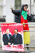 "A Cameroonian activist gestures as she speaks in Whitehall, nearby Downing Street prior to French President Emanuel Macron's visit in London, on Thursday, June 18, 2020. They say France is involved in the looting of Cameroon and Africa. A letter addressing the press and members of the public says: ""We are here to tell Mr Macron this is unacceptable. Enough is enough!"".<br /> For his first foreign trip since lockdown, Emmanuel Macron will be in London to mark the 80th anniversary of de Gaulle's « appel de Londres », as well as cement Franco-UK ties at a strained time due to Brexit. (Photo/ Vudi Xhymshiti)"