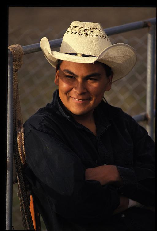 Marty John (22).  Bull riding practice at A-M Arena, $7 per ride.  Shiprock, NM  1993