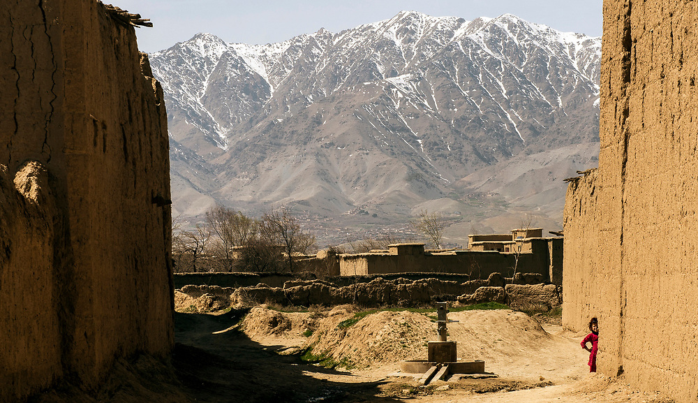 A Afghan girl watches U.S Air Force Airmen patrol through her village outside of Bagram Air Base, Afghanistan.(U.S. Air Force photo by Staff Sgt. Perry Aston/Released)