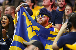 Jan 12, 2019; Morgantown, WV, USA; A West Virginia Mountaineers fan cheers during the second half against the Oklahoma State Cowboys at WVU Coliseum. Mandatory Credit: Ben Queen-USA TODAY Sports