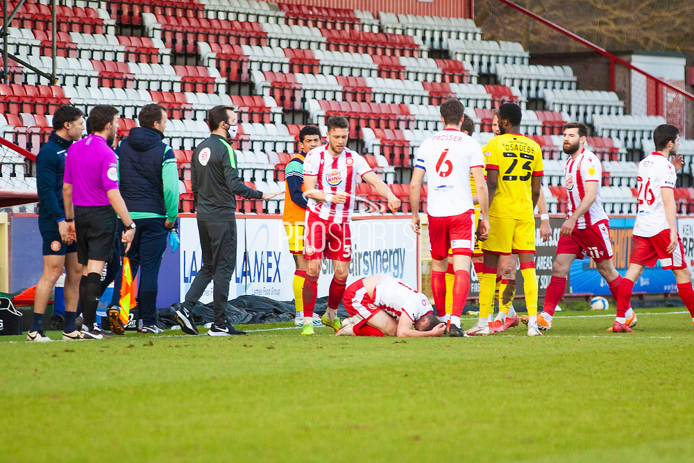 Hands on argument going down because a Walsall player tackled Stevenage player Charlie Carter of Stevenage extreamly hard during the EFL Sky Bet League 2 match between Stevenage and Walsall at the Lamex Stadium, Stevenage, England on 20 February 2021.