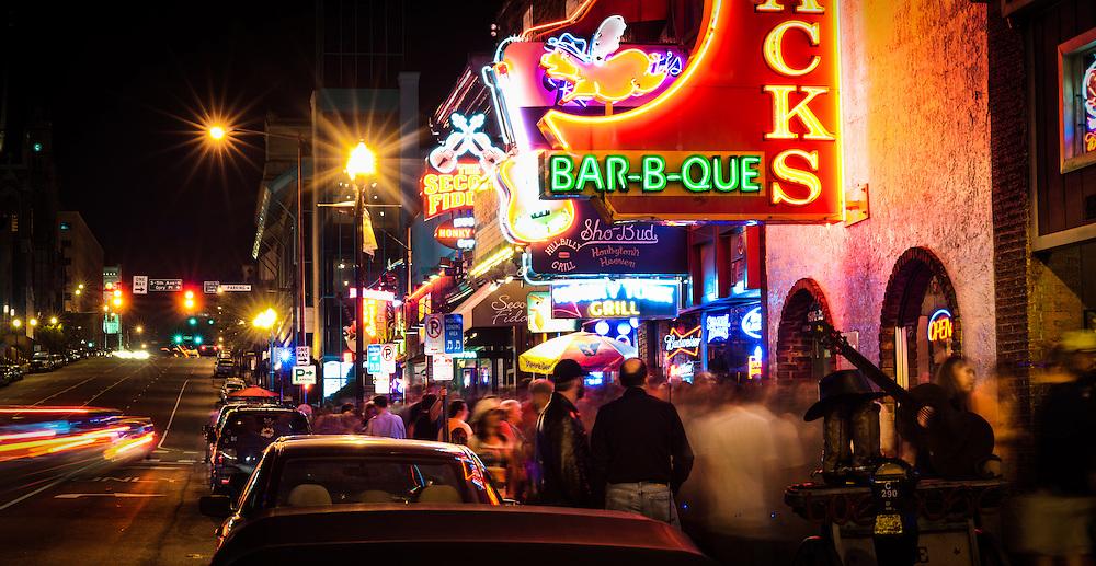 The evening crowd walks along Broadway in downtown Nashville, TN.