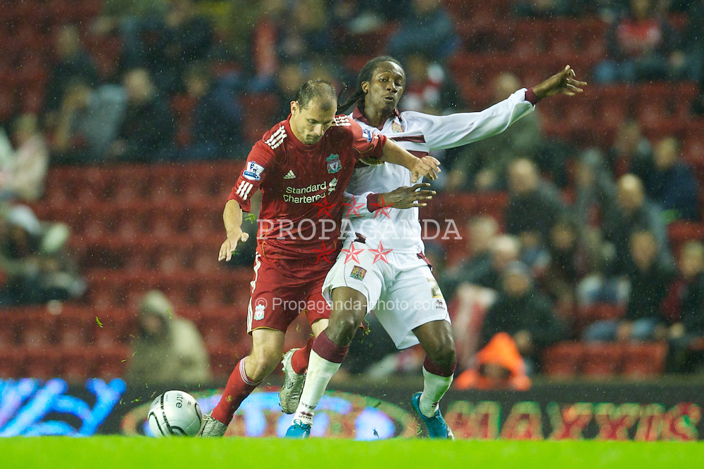 LIVERPOOL, ENGLAND - Wednesday, September 22, 2010: Liverpool's Milan Jovanovic and Northampton Town's Paul Rodgers during the Football League Cup 3rd Round match at Anfield. (Photo by David Rawcliffe/Propaganda)