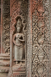 Bas-reliefs of Aspara dancers and red lichen at Preah Kan temple, built 1191.