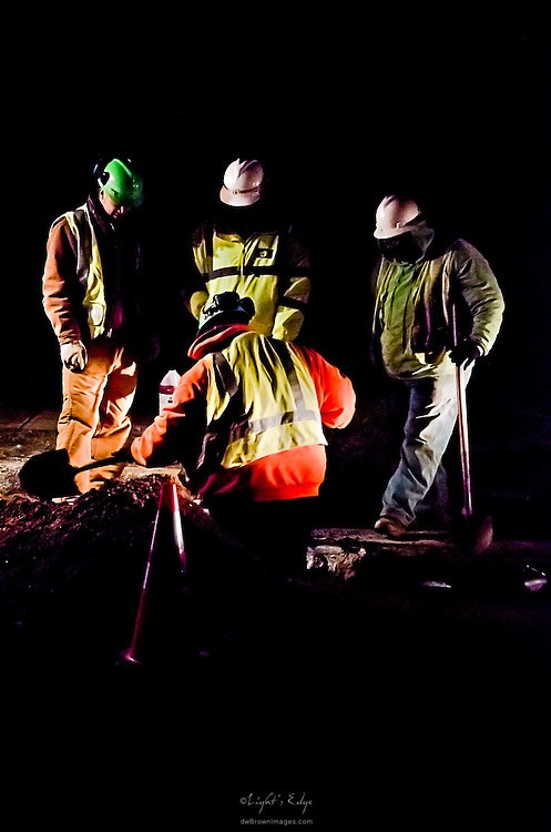 A night crew from South Jersey Gas Co. working to repair a leak under a street following the replacement of a gas main.