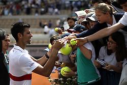 May 30, 2018 - Paris, Ile-de-France, France - Novak Djokovic of Serbia sign his ball during the second round at Roland Garros Grand Slam Tournament - Day 4 on May 30, 2018 in Paris, France. (Credit Image: © Mehdi Taamallah/NurPhoto via ZUMA Press)